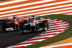 Michael Schumacher, Mercedes GP Petronas F1 Team leads Fernando Alonso, Scuderia Ferrari