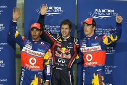 Pole winner Sebastian Vettel, Red Bull Racing, second place Lewis Hamilton, McLaren Mercedes, third place Jenson Button, McLaren Mercedes