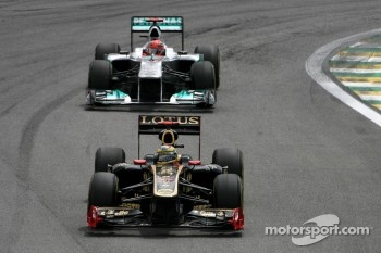 Bruno Senna, Renault F1 Team and Michael Schumacher, Mercedes GP