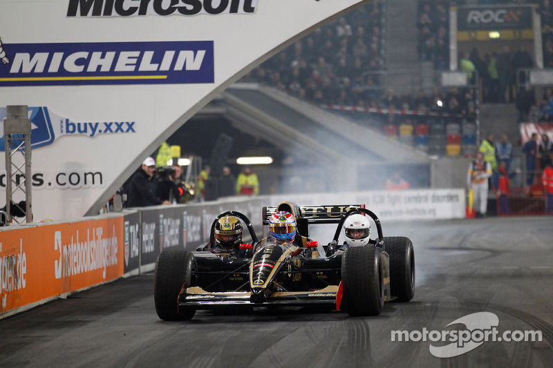 Vitaly Petrov drives the three-seater Lotus Renault