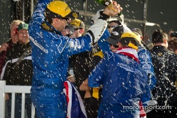 DP podium: A.J. Allmendinger and Justin Wilson celebrate