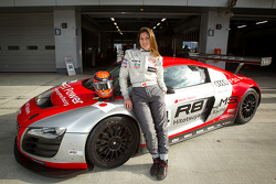 Cyndie Allemann poses with the Hitotsuyama Racing Audi R8 LMS Super GT car