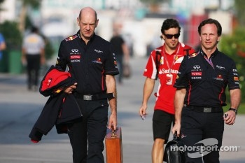 Adrian Newey, Red Bull Racing Chief Technical Officer with Christian Horner, Red Bull Racing Team Principal and Fernando Alonso, Ferrari in the background