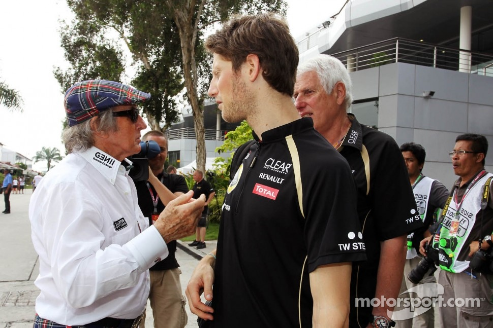 Jackie Stewart, with Romain Grosjean, Lotus F1 Team