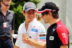 Kamui Kobayashi, Sauber with Timo Glock, Marussia F1 Team