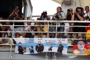 Fans and a banner for Kimi Raikkonen, Lotus F1 Team