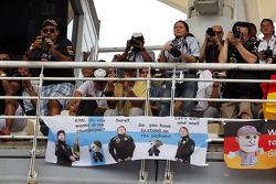 Fans and a banner for Kimi Raikkonen, Lotus F1 Team
