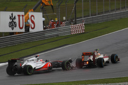 Jenson Button, McLaren Mercedes and Narain Karthikeyan, HRT Formula One Team make contact