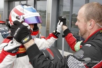 Qualifying race winner Stphane Ortelli celebrates