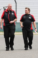 John Booth, Marussia F1 Team Team Principal, walks the circuit
