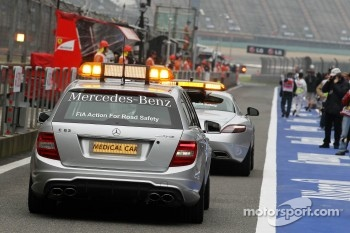 The FIA Medical Car follows the Safety Car out of the pits