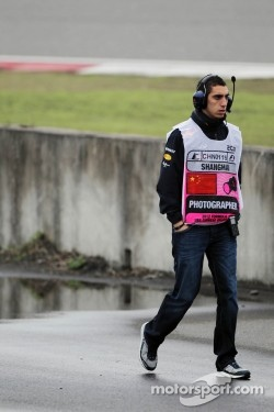 Sebastien Buemi, Red Bull Racing and Scuderia Toro Rosso Reserve Driver watches practice trackside