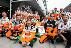 The Sahara Force India F1 Team mechanics celebrate winning the Sky Sports F1 trophy for the fastest pit stop at the Malaysian GP