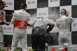 Norbert Haug receiving a champagne bath on the Chinese GP podium