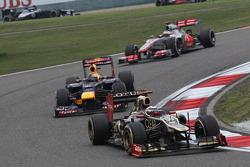 Kimi Raikkonen, Lotus Renault F1 Team leads Sebastian Vettel, Red Bull Racing