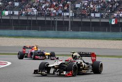 Romain Grosjean, Lotus F1 leads Sebastian Vettel, Red Bull Racing