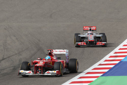Fernando Alonso, Ferrari leads Jenson Button, McLaren
