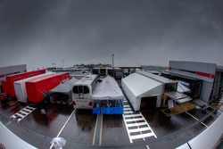 Paddock area under a menacing sky