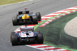 Heikki Kovalainen, Caterham leads Bruno Senna, Williams