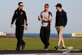 Craig Lowndes walks the track