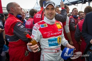 Race winner Markus Winkelhock celebrates with Audi Sport Team Phoenix team members