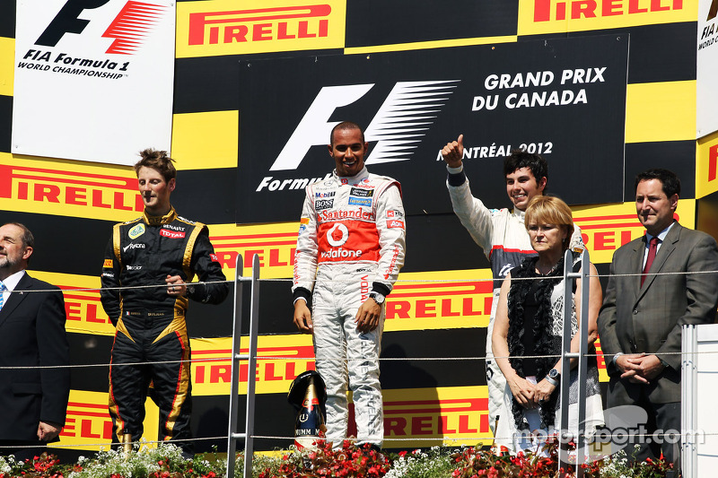 The podium, Romain Grosjean, Lotus F1 Team, second; Lewis Hamilton, McLaren Mercedes, race winner; Sergio Perez, Sauber, third