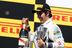 Sergio Perez, Sauber celebrates his third position on the podium