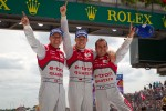 Race winners Marcel Fässler, Andre Lotterer and Benoit Tréluyer celebrate