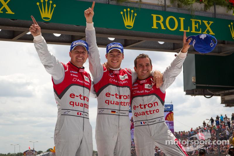 Race winners Marcel Fässler, Andre Lotterer and Benoit Tréluyer celebrate