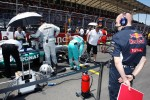 Adrian Newey, Red Bull Racing Chief Technical Officer looks at the Mercedes AMG F1 of Nico Rosberg, Mercedes AMG F1 on the grid