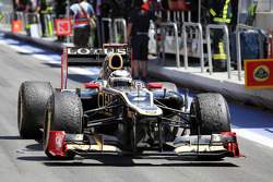 Second placed Kimi Raikkonen, Lotus F1 enters parc ferme