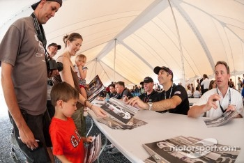 Action Express drivers sign autographs for fans