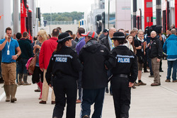 Police escort an unauthorised person in the paddock