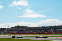 Lewis Hamilton, McLaren leads Sergio Perez, Sauber