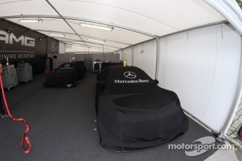 The cars of Ralf Schumacher, Team HWA AMG Mercedes, AMG Mercedes C-Coupe and Jamie Green, Team HWA AMG Mercedes, AMG Mercedes C-Coupe sit in their tent, with the champagne bottles from saturdays team relays