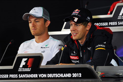 Nico Rosberg, Mercedes AMG F1 and Sebastian Vettel, Red Bull Racing in the FIA Press Conference