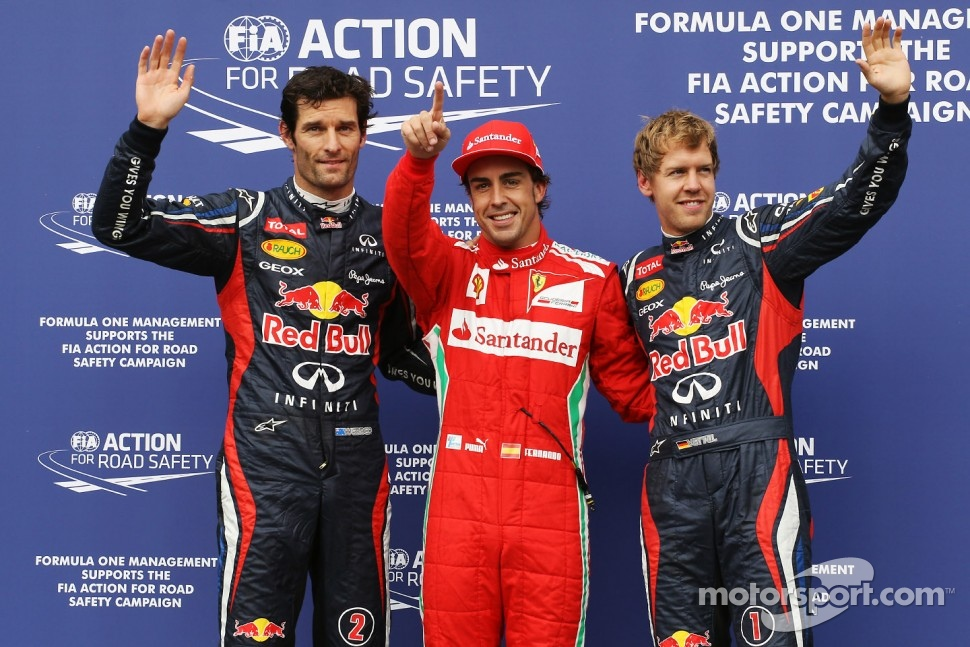 Qualifying parc ferme, Red Bull Racing, third; Fernando Alonso, Ferrari, pole position; Sebastian Vettel, Red Bull Racing, third