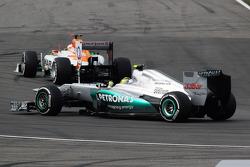 Paul di Resta, Sahara Force India leads Nico Rosberg, Mercedes AMG F1