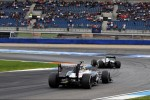 Nico Rosberg, Mercedes AMG F1 leads Bruno Senna, Williams