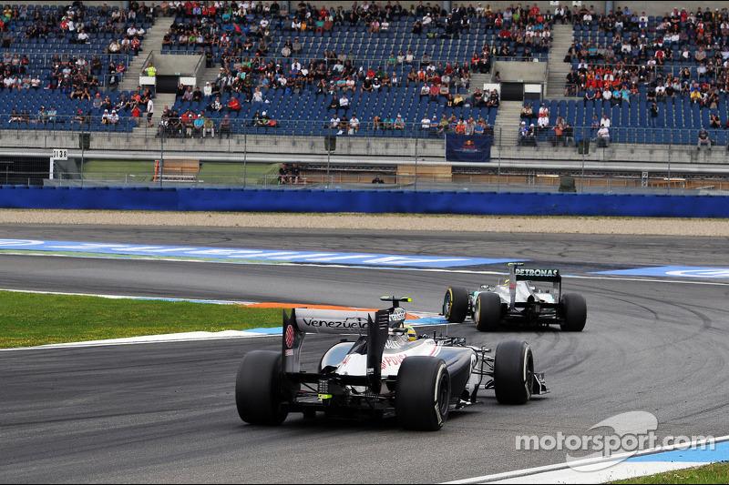 Nico Rosberg, Mercedes AMG F1 leads Bruno Senna, Williams