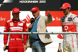 Podium: Fernando Alonso, Scuderia Ferrari celebrates with third placed Jenson Button, McLaren with Niki Lauda