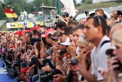Fans enjoy the pit lane walkabout