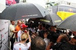 Lewis Hamilton, McLaren with the media in the rain