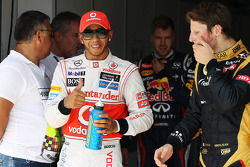 Lewis Hamilton, McLaren, celebrates his pole position in parc ferme with Romain Grosjean, Lotus F1 Team and Sebastian Vettel, Red Bull Racing