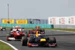 Sebastian Vettel, Red Bull Racing leads Fernando Alonso, Scuderia Ferrari