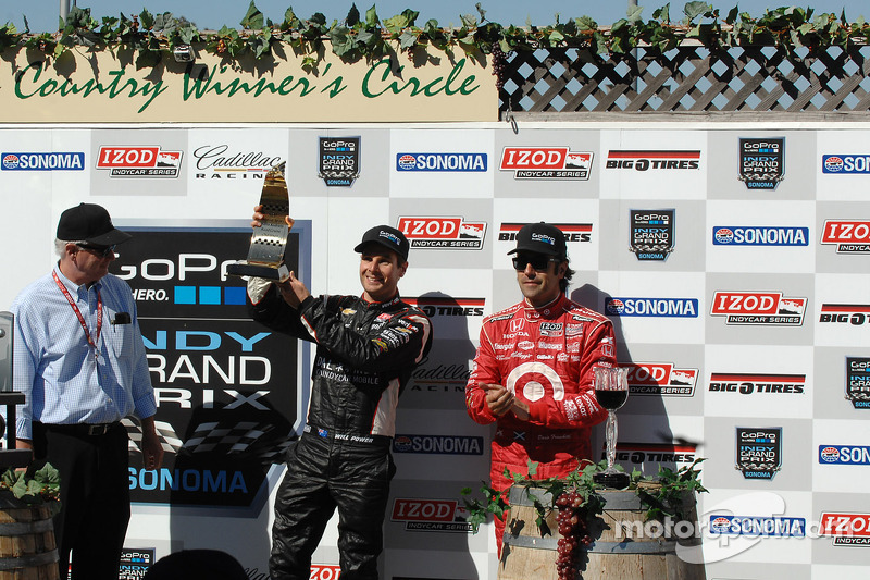 Victory lane: second place Will Power, third place Dario Franchitti