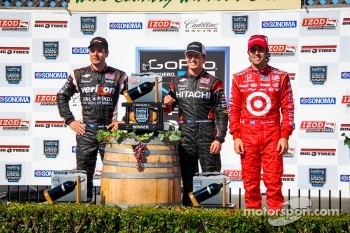 Victory lane: race winner Ryan Briscoe, second place Will Power, third place Dario Franchitti