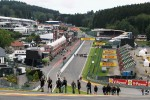 Romain Grosjean, Lotus F1 Team walks the circuit and climbs Eau Rouge