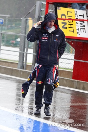 Sebastian Vettel, Red Bull Racing walking in the wet pitlane