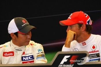 Kamui Kobayashi, Sauber F1 Team and Jenson Button, McLaren Mercedes